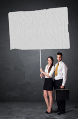 Business couple with blank booklet paper