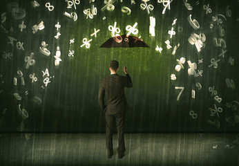 Businessman standing with umbrella and 3d numbers raining concep