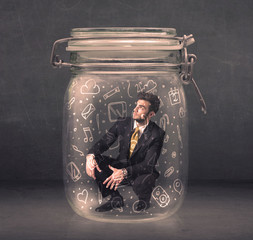 Business man captured in glass jar with hand drawn media icons c