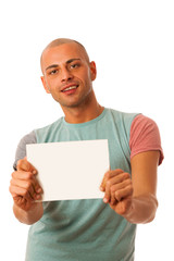 Handsome young man presenting situation with blank card in his h
