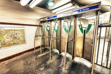 Entrance gates of Paris Metro. Subway interior view