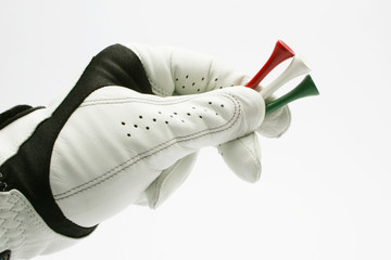 Golf glove with colored tees