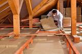 Man laying thermal insulation layer