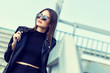 canvas print picture - fashion model in sunglasses posing outdoor