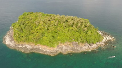 Island in the ocean from a height of 50 meters.