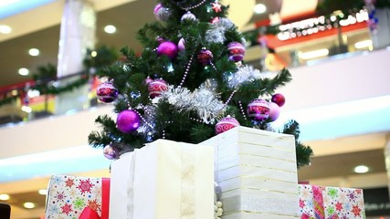 Christmas gifts under tree. Shift motion with change focus on