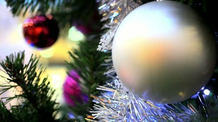 Christmas scene with tree and colordul balls, close-up. HD.