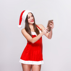 Woman with tablet in christmas outfit