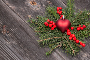 Christmas decoration on wood background, red heart
