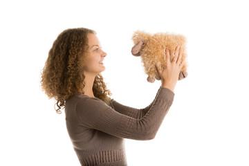 Girl holds stuffed toy sheep