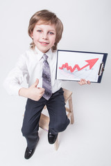 successful businessman shows a graph of profit growth