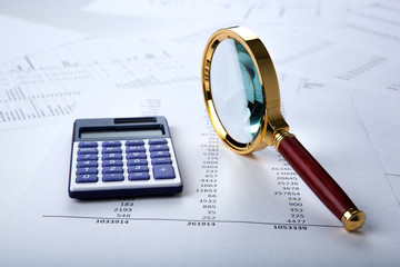work with a magnifying glass, a calculator
