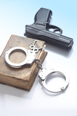 handcuffs and book on law and gun