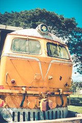 yellow train and blue sky in vintage style