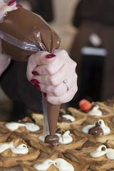 hands preparing cake
