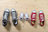 three pair of shoes in family togetherness concept