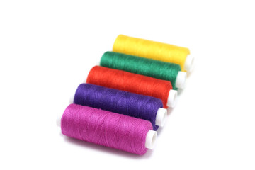 several coils colored thread on a white background