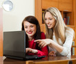 Happy women together with laptop
