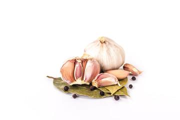 onions and garlic on a bay leaf