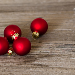 red christmas balls on wooden background