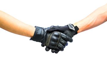Two hands biker gloves meet in hand shake
