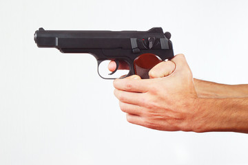 Hands with pistol on a white background