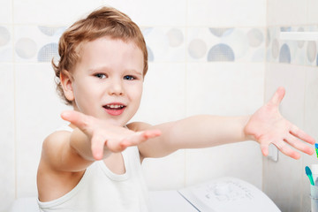 Cute happy kid showing washed hands