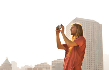 Man taking Picture on a bright Day