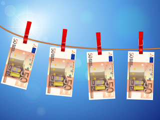 fifty euro banknotes on clothesline