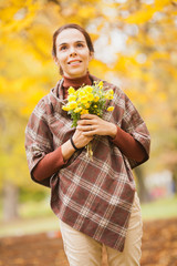 Portrait of a beautiful young woman with bouquet