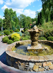 The original decorative fountain in a botanical garden