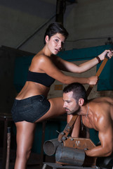 woman and man in factory , posing with tools