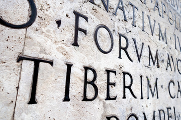 Latin inscription on  wall in Rome, Italy