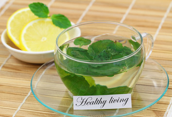Healthy living card with cup of fresh mint tea