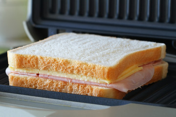 Toast with ham and cheese in toaster