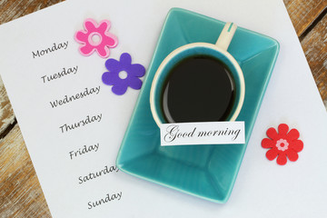 Good morning card with cup of tea and days of the week on paper