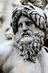 Face of Zeus in Piazza Navona fountain, Rome Italy
