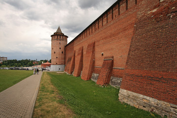 People walk by old walls of Kolomna Kremlin