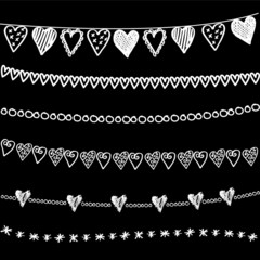 Set of chalk doodle hand drawn garlands, borders on blackboard
