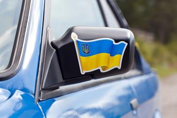 Blue sport car, mirror
