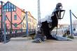 Leinwanddruck Bild - statue of the creeping ghost on the embankment of Klaipeda, Lith