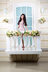 young beautiful woman relaxing on a balcony