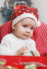 baby  in a cap of Santa