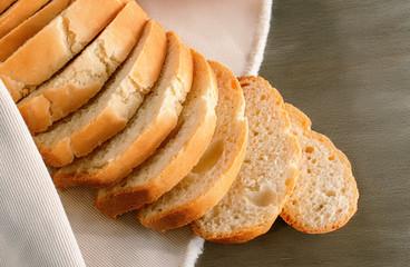 Sliced bread on the linen napkin