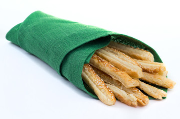 Sticks of puff pastry in a napkin
