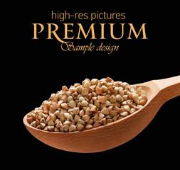 Buckwheat groats in a wooden spoon