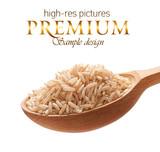 Unpolished rice in a wooden spoon  isolated on white background poster