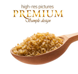 Bulgur in a wooden spoon  isolated on white background