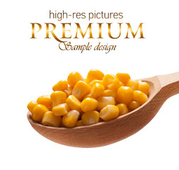 Canned corn in a wooden spoon  isolated on white background
