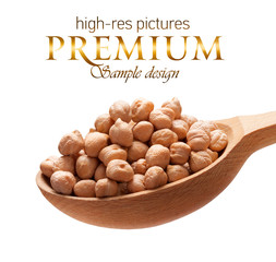 Chickpea in a wooden spoon  isolated on white background